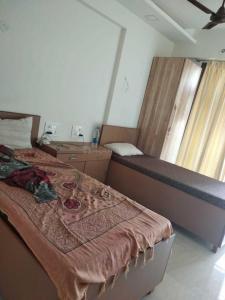बोरीवली ईस्ट में सवास पीजी में बेडरूम की तस्वीर