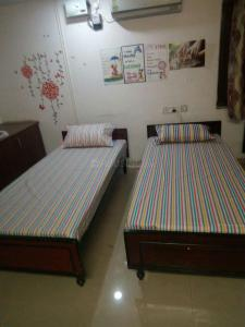 Bedroom Image of Paying Guest Accommodation With Food Available In Thane Ynh in Kasarvadavali, Thane West