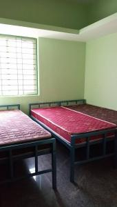 Bedroom Image of Bhuvana Ladies PG in Sahakara Nagar