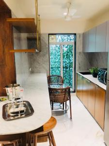 Kitchen Image of 984 Sq.ft 2 BHK Apartment for buy in J.K IRIS, Mira Road East for 7795000