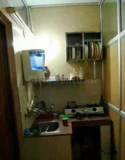 कालकाजी में यूनिक पीजी में किचन की तस्वीर
