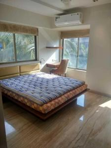 Gallery Cover Image of 915 Sq.ft 2 BHK Apartment for rent in Juhu for 110000
