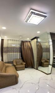 Gallery Cover Image of 686 Sq.ft 2 BHK Apartment for buy in Om Paraiso, Padle Gaon for 6500000