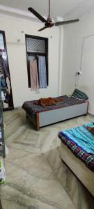 Bedroom Image of White House PG in Mukherjee Nagar