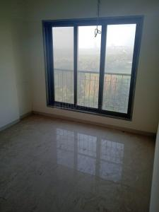 Gallery Cover Image of 750 Sq.ft 1 BHK Apartment for buy in Abhigna Avirahi Heights, Malad West for 9000000