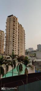 Gallery Cover Image of 1000 Sq.ft 2 BHK Apartment for buy in Gurukrupa Guru Atman, Kalyan West for 6300000