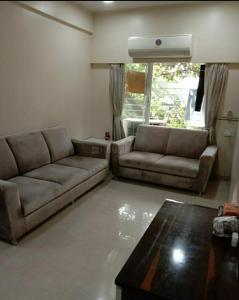 Gallery Cover Image of 850 Sq.ft 2 BHK Apartment for rent in Sai Sai Siddhi Towers, Ghatkopar East for 38000