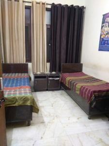 Bedroom Image of Devine PG in Govindpuri
