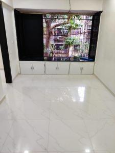 Gallery Cover Image of 450 Sq.ft 1 RK Apartment for rent in Saraf Chaudhary Nagar CHS, Kandivali East for 15000