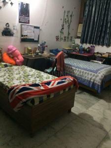 Bedroom Image of Ggirls PG in Kamla Nagar