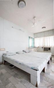 Bedroom Image of Hetal Shah Paying Guest Accommodation in Makarba
