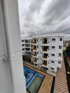 Gallery Cover Image of 1185 Sq.ft 2 BHK Apartment for buy in Vaishno Solitaire, Ramamurthy Nagar for 7347000