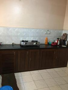Kitchen Image of Lumbini PG For Girls in Koramangala