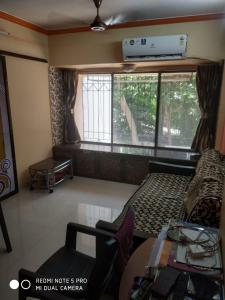 Gallery Cover Image of 660 Sq.ft 1 BHK Apartment for rent in Atul Blue Oasis, Kandivali West for 22500