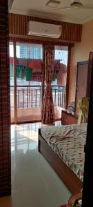 Gallery Cover Image of 1400 Sq.ft 2 BHK Apartment for rent in Satellite Satellite Tower, Goregaon East for 55000