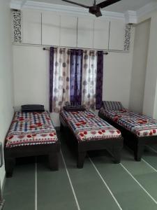 Bedroom Image of Muktidham Apartment in Thaltej