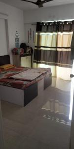 Gallery Cover Image of 1250 Sq.ft 2 BHK Apartment for rent in Karia Konark Orchid, Wagholi for 15000