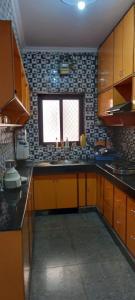 Kitchen Image of Luxury Maya PG in Sector 12 Dwarka