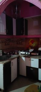 Kitchen Image of Maaz Girls PG in Sector 48