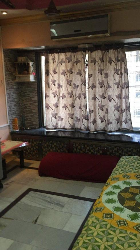 Living Room Image of 400 Sq.ft 1 RK Apartment for rent in Kandivali East for 15000