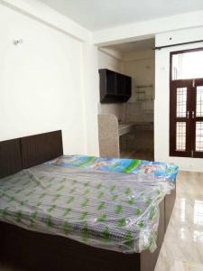 Gallery Cover Image of 900 Sq.ft 2 BHK Apartment for rent in Palam Vihar Extension for 15250