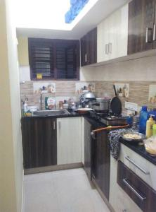 Kitchen Image of Harish Nest PG in Bommanahalli