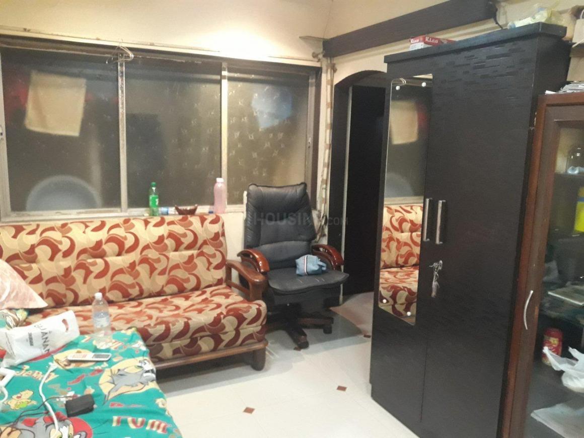 Living Room Image of 670 Sq.ft 1 BHK Apartment for rent in Kopar Khairane for 18000