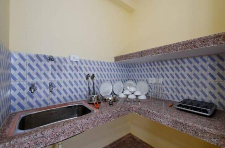 महादेव पीजी इन सेक्टर 46 के किचन की तस्वीर