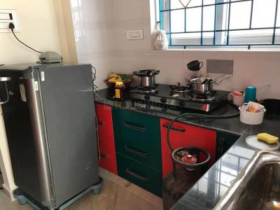 Kitchen Image of Ars Ladies Hostel in Vasundhara Enclave