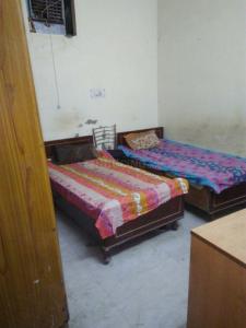Bedroom Image of Krishna Boyes PG in Baljit Nagar