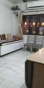 Gallery Cover Image of 900 Sq.ft 2 BHK Apartment for rent in Neelyog Apartment, Ghatkopar West for 40000