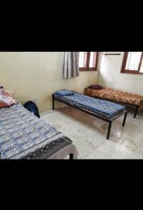 Bedroom Image of Singh PG Home in Govindpuri