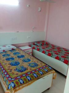 Bedroom Image of Shri Sai Kripa PG in Krishna Nagar