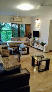 Gallery Cover Image of 1200 Sq.ft 2 BHK Apartment for rent in The Spring Fields, Andheri West for 50000