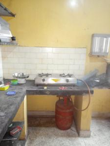 Kitchen Image of Boys PG in Kaikhali
