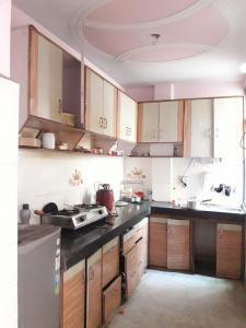 Kitchen Image of Gupta PG in Rajouri Garden