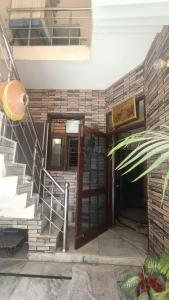 Gallery Cover Image of 900 Sq.ft 3 BHK Independent House for buy in Dhakoli for 4600000