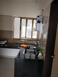 Kitchen Image of Ashok Apartment PG in Vile Parle West