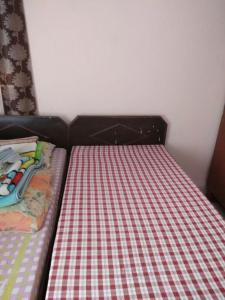 Bedroom Image of Harmeet Singh PG in Rajouri Garden