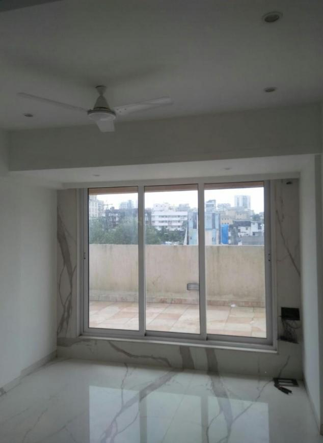 Living Room Image of 1040 Sq.ft 3 BHK Apartment for buy in Khar West for 32500000