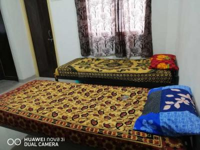 Bedroom Image of Shree Sai Ram PG in Wadgaon Sheri