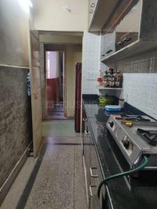 Kitchen Image of Girish Park Boys PG in Beniatola