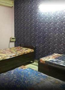 Bedroom Image of Ganpati PG For Boys in Chirag Dilli