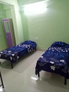 Bedroom Image of Shree Venkat Sai Luxury PG in Wadgaon Sheri