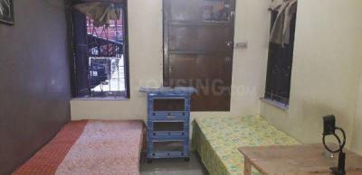 Bedroom Image of Debroy PG in New Alipore