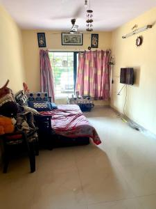 Gallery Cover Image of 580 Sq.ft 1 BHK Apartment for rent in Lok Raunak, Andheri East for 25000