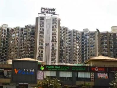 Gallery Cover Image of 2115 Sq.ft 4 BHK Apartment for buy in Prateek Wisteria, Sector 77 for 12500000