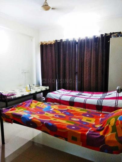 पिंपले निलख में हैप्पी नेस्ट पीजी के बेडरूम की तस्वीर