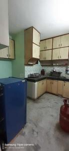 Kitchen Image of Joy Homes PG in Mehrauli