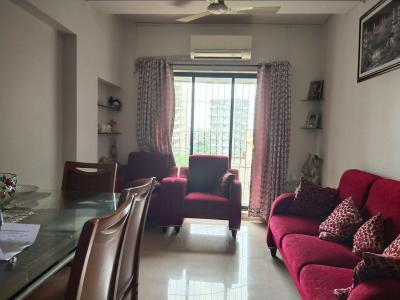 Gallery Cover Image of 810 Sq.ft 2 BHK Apartment for buy in DLH New Chandra CHS, Andheri West for 18500000